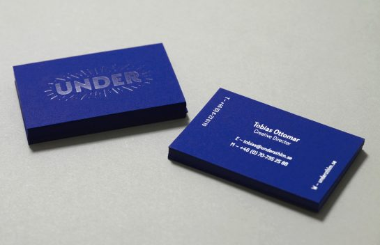 Under business card